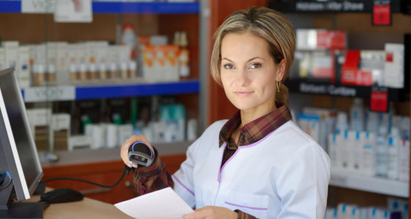 female pharmacist holding prescription